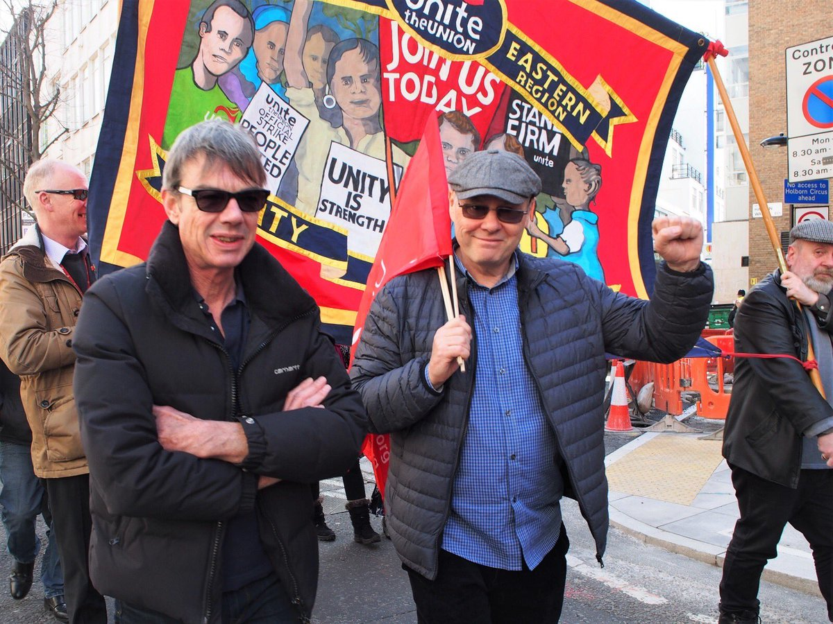 Jim Kelly – with fist raised